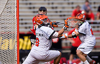 Adam Ghitelman (8) of Virginia makes a save during the ACC men's lacrosse tournament finals in College Park, MD.  Virginia defeated Maryland, 10-6.