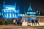 © Joel Goodman - 07973 332324. 26/09/2017. Brighton, UK. People finishing a late shift and others catching an early bus wait at an art-deco bus stop in front of the Royal Pavilion . Revellers at the end of a night out in Brighton during Freshers week , when university students traditionally enjoy the bars and clubs during their first nights out in a new city . Photo credit : Joel Goodman