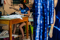 A Salvadoran seamstress sews a white dress, dyed with the natural blue indigo afterwards, in an artisanal clothing workshop in Santiago Nonualco, El Salvador, 6 April 2018. For centuries, indigo, a natural deep blue dye extracted from the leaves of tropical plants, has been known to the native indigenous inhabitants of Central America. Nowadays, a growing demand for handmade, nature-based products has has permitted the emergence of various clothing workshops and cooperatives. Employing traditional design techniques and inspired by the ancient Mayan artists, they produce fashion collections, clothing accessories or decorative items on a sustainable, small scale basis.