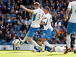 Bilel Mohsni stoops to fire Rangers ahead with a diving header