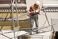- Operai edili sul ponteggio per la ristrutturazione di un palazzo<br /> <br /> - Construction workers on the scaffolding for the renovation of a building