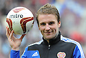 Hearts' hat trick hero Ryan Stevenson keeps the ball at the end of the game.