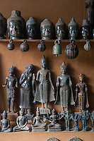 Lost wax bronze statues of Buddha's and Buddha heads in the main handicraft market - Siem Reap, Cambodia.