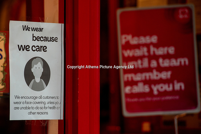 Pictured: Face covering sign on display in Llanelli Town Centre, Llanelli, Wales, UK. Sunday 27 September 2020<br /> Re: Local lockdown will be in force from 6pm on the 27th of September, due to the Covid-19 Coronavirus pandemic, in Llanelli, Wales, UK