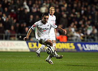 Pictured: Leon Britton of Swansea City in action <br />