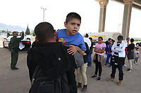El Paso, Tx - NEWS:   Ride along with Customs and Border Protection agents, El Paso, Tx, Monday, April 29, 2019.<br /> <br /> PICTURED:  El Salvadoran migrant Darwin Hernandez, 33, and his son Jose Arnalfo Hernandez Canales, 9, are part of a group of 18 migrants - including 2 children and a a teenager - seeking asylum in the USA, that turned themselves in to border patrol agents near the border fence.  Hernandez's son Jose is stricken with cerebral palsy and cannot walk well on his own.<br /> This area is called 'Nicholson's Crossing' by border patrol agents.  <br /> <br /> <br /> (Angel Chevrestt, 646.314.3206)