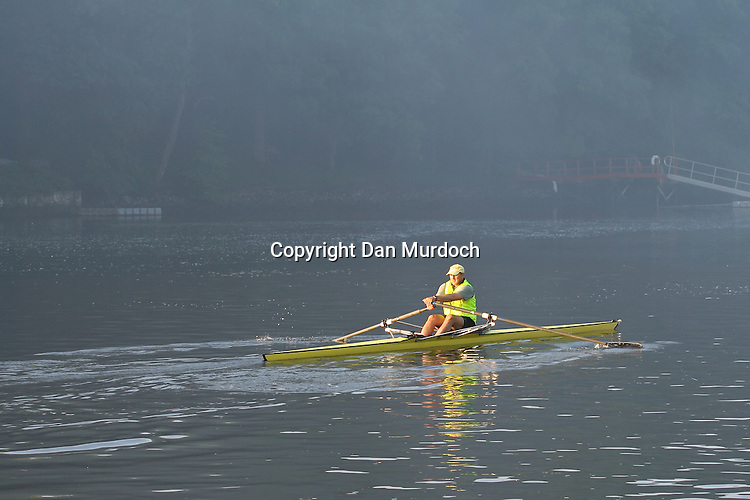 An early morning row on a misty river