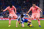 Marc Roca of RCD Espanyol (C) battles for the ball with Sergio Busquets (R) and Ousmane Dembele of FC Barcelona (L) during the La Liga 2018-19 match between RDC Espanyol and FC Barcelona at Camp Nou on 08 December 2018 in Barcelona, Spain. Photo by Vicens Gimenez / Power Sport Images