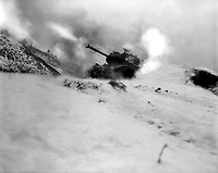 Near Song Sil-li, Korea, a tank of 6th Tank Bn. fires on enemy positions in support of the 19th RCT.  January 10, 1952.  Pfc. Harry M. Schultz.  (Army)<br /> NARA FILE #:  111-SC-389600<br /> WAR & CONFLICT BOOK #:  1438