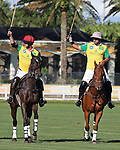 WELLINGTON, FL - NOVEMBER 25:  Team Brazil,  Gustavo Toledo and Caio Mello,  wave to the crowd as they pass by the stands, at the USPA International Cup at the Grand Champions Polo Club, on November 25, 2017 in Wellington, Florida. (Photo by Liz Lamont/Eclipse Sportswire/Getty Images)