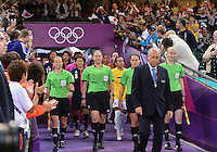 August 03, 2012 - Cardiff England - FIFA Coordinator leads the match officials and the teams on to the field before Group F match between JPN and BRA at the Millennium Stadium. .