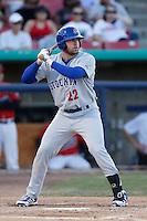 Josh Whitaker #22 of the Stockton Ports bats against the High Desert Mavericks at Stater Bros. Stadium on April 27, 2013 in Adelanto, California. Stockton defeated High Desert, 17-7. (Larry Goren/Four Seam Images)