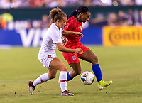 PHILADELPHIA, PA - AUGUST 29: Matilde Fidalgo #5 of Portugal fights for the ball with Crystal Dunn #19 of the United States during a game between Portugal and the USWNT at Lincoln Financial Field on August 29, 2019 in Philadelphia, PA.