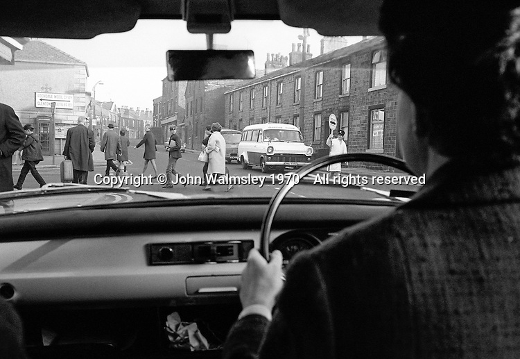 Teacher driving to school in the morning, Whitworth Comprehensive School, Whitworth, Lancashire.  1970.