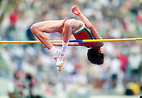 Female high-jumper clears bar on her jump