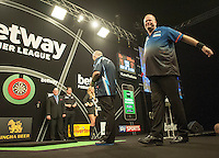 09.04.2015. Sheffield, England. Betway Premier League Darts. Matchday 10.  Phil Taylor [ENG] prepares to throw while Raymond van Barneveld [NED] limbers up.