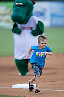 A young fan competes in the mascot race between innings of the South Atlantic League game between the West Virginia Power and the Kannapolis Intimidators at Kannapolis Intimidators Stadium on June 18, 2017 in Kannapolis, North Carolina.  The Intimidators defeated the Power 5-3 to win the South Atlantic League Northern Division first half title.  It is the first trip to the playoffs for the Intimidators since 2009.  (Brian Westerholt/Four Seam Images)