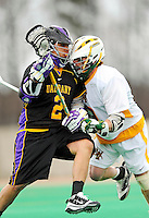 10 April 2011: University at Albany Great Dane attacker Miles Thompson, a Freshman from Nedrow, NY, in action against Evan O'Brien of the University of Vermont Catamounts at Moulton Winder Field in Burlington, Vermont. The Catamounts defeated the visiting Danes 11-6 in America East play. Mandatory Credit: Ed Wolfstein Photo