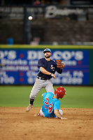 Charlotte Stone Crabs second baseman Jake Palomaki (11) throws to first base as Matt Vierling (28) slides in during a Florida State League game against the Clearwater Beach Dogs on July 26, 2019 at Spectrum Field in Clearwater, Florida.  Clearwater defeated Charlotte 6-5.  (Mike Janes/Four Seam Images)