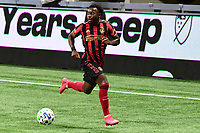 ATLANTA, GA - AUGUST 22: George Bello #21 dribbles the ball during a game between Nashville SC and Atlanta United FC at Mercedes-Benz Stadium on August 22, 2020 in Atlanta, Georgia.