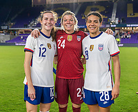 ORLANDO, FL - JANUARY 22: Tierna Davidson #12, Jane Campbell #24 and Alana Cook #28 of the USWNT pose for a photo after a game between Colombia and USWNT at Exploria stadium on January 22, 2021 in Orlando, Florida.