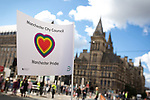 "© Joel Goodman - 07973 332324 . 23/08/2014 .  Manchester , UK . Manchester City Council Pride flag and Manchester Town Hall in the background . The parade through Manchester City Centre . Manchester Pride "" Big Weekend "" in Manchester "" today ( 23rd August 2014 ) . Photo credit : Joel Goodman"