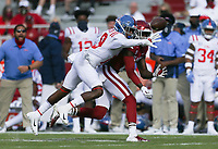 Ole Miss running back Jerrion Ealy (9) blocks a pass intended for Arkansas wide receiver Mike Woods (8), Saturday, October 17, 2020 during the first quarter of a football game at Donald W. Reynolds Razorback Stadium in Fayetteville. Check out nwaonline.com/201018Daily/ for today's photo gallery. <br /> (NWA Democrat-Gazette/Charlie Kaijo)