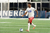 FOXBOROUGH, MA - OCTOBER 16: Nkosi Burgess #29 of North Texas SC brings the ball forward during a game between North Texas SC and New England Revolution II at Gillette Stadium on October 16, 2020 in Foxborough, Massachusetts.