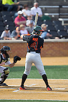 Johnny Ruiz (4) of the Miami Hurricanes at bat against the Wake Forest Demon Deacons at Wake Forest Baseball Park on March 21, 2015 in Winston-Salem, North Carolina.  The Hurricanes defeated the Demon Deacons 12-7.  (Brian Westerholt/Four Seam Images)