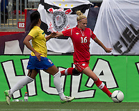 Canadian defender  Lauren Sesselmann (16) passes the ball. In an international friendly, Canada defeated Brasil, 2-1, at Gillette Stadium on March 24, 2012.