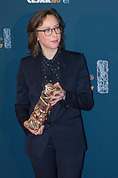 "French film director and screenwriter Celine Sciamma poses with her trophy during a photocall after winning the Best Adaptation award for ""Ma vie de Courgette"" (My Life as a Courgette) during the 42nd edition of the Cesar Ceremony at the Salle Pleyel in Paris on February 24, 2017."