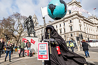 London, England on 15 March 2019: a the death mask no-capitalism during the youth climate strike in London. The protest against climate change and urge the government to take action.The global movement has been inspired by teenage activist Greta Thunberg, who has been skipping school every Friday since August to protest outside the Swedish parliament. Photo Adamo Di Loreto/BunaVista*photo