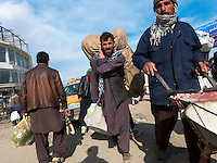 Porters in Kabul Bazar, one of the busiest in the country
