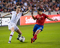 HOUSTON, TX - FEBRUARY 03: Emily Sonnett #2 of the USA attacks with the ball against Lixy Rodriguez #12 of Costa Rica during a game between Costa Rica and USWNT at BBVA Stadium on February 03, 2020 in Houston, Texas.