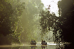 Tourist wildlife watching just after dawn. Menanggol River, Kinabatangan, Sabah, Borneo.