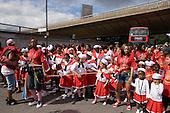 Flamboyan mas band wait under the Westway flyover on Children's Day at Notting Hill Carnival