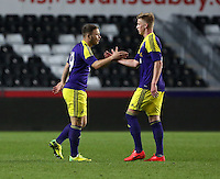 Thursday, 16 April 2014<br /> Pictured L-R: Kyle Copp of Swansea celebrating his goal with team mate Adam King <br /> Re: FAW Youth Cup Final, Swansea City FC v The New Saints FC at the Liberty Stadium, south Wales,
