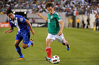 Andres Guardado (18) of Mexico is defended by Jonathan Lopez (24) of Guatemala. Mexico defeated Guatemala 2-1 during a quarterfinal match of the 2011 CONCACAF Gold Cup at the New Meadowlands Stadium in East Rutherford, NJ, on June 18, 2011.