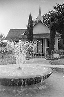 Fountain and small white chapel at the base of the Granada Bridge in Ormond Beach, Florida, shot on expired T-Max 400 film with an Argus 100, 35mm film camera, August 2018.  (Photo by Brian Cleary/www.bcpix.com)
