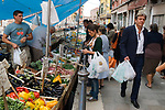 Venice Italy 2009. People doing vegetable daily shopping on canal boat Arsenale Venice.