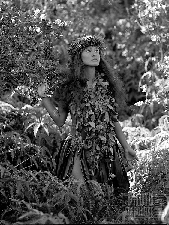 Young Hawaiian girl  near Steam Vents in Hawaii Volcanoes National Park, wearing maile lei and lei poo (head lei).