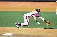 Cincinnati Bearcats shortstop Ian Happ (5) tracks a ground ball against the Radford Highlanders at Wake Forest Baseball Park on February 22, 2014 in Winston-Salem, North Carolina.  The Highlanders defeated the Bearcats 6-5.  (Brian Westerholt/Four Seam Images)