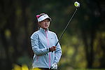 Simin Feng of China lines up a putt during the Hyundai China Ladies Open 2014 at World Cup Course in Mission Hills Shenzhen on December 13 2014, in Shenzhen, China. Photo by Xaume Olleros / Power Sport Images