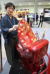 """February 23, 2017, Tokyo, Japan - Japan's toilet  wholesaler Sakamoto unveils a gorgeous toilet """"Bidocoro"""" with a price of 10 million yen (90,000 US dollars) decorated with Japanese traditional lacquerware art with gold dusts and studded with diamonds and swarovski crystals at the annual Hotel and Restaurant Show in Tokyo on Thursday, February 23, 2017.   (Photo by Yoshio Tsunoda/AFLO) LwX -ytd-"""