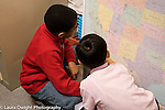 Education Elementary Grade 3 two boys looking at map of the USA