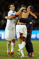 Carlos Bocanegra (left) of USA celebrates with team-mate Oguchi Onyewu (center) at full-time. USA defeated Spain 2-0 during the semi-finals of the FIFA Confederations Cup at Free State Stadium in Manguang/Bloemfontein, South Africa on June 24, 2009..