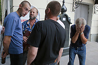 Moscow, Russia, 25/07/2010..A drunk man staggers with his head in his hands while others sing songs by Vladimir Vysotsky as hundreds of Russians gather at the grave of the legendary bard singer, poet and actor to mark the 30th anniversary of his death. Vysotsky, an alcoholic and heroin addict who died in 1980 aged 42 of a heart attack, is best known for his songs of Soviet prison and military life, and his acting on stage and screen. Much of his work was officially unpublished during his lifetime, and he remains a potent anti-authoritarian symbol of protest to Russians of all ages even today.