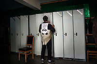 A researcher dresses in a panda costume in the changing rooms at the Hetaoping Panda Conservation Centre. The researchers wear the panda costumes to prevent the wild pandas from becoming accustomed to humans.