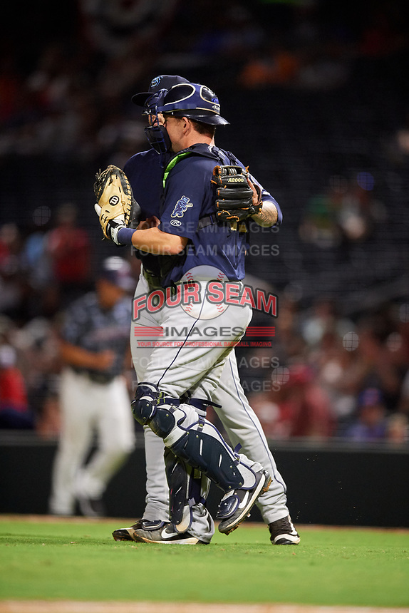 Mobile BayBears relief pitcher Sean Isaac (37) meets with Michael Barash (16) during a game against the Jacksonville Jumbo Shrimp on April 14, 2018 at Baseball Grounds of Jacksonville in Jacksonville, Florida.  Mobile defeated Jacksonville 13-3.  (Mike Janes/Four Seam Images)
