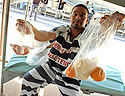 AJ ALEXANDER/AJA  90204-  A TENT CITY Undocumented Inmate displays his lunch bags that they are given. At the Maricopa County Sheriffs Jails in Phoenix, Arizona.Photo by AJ ALEXANDER (c)